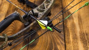 camouflage compound hunting bow with arrow