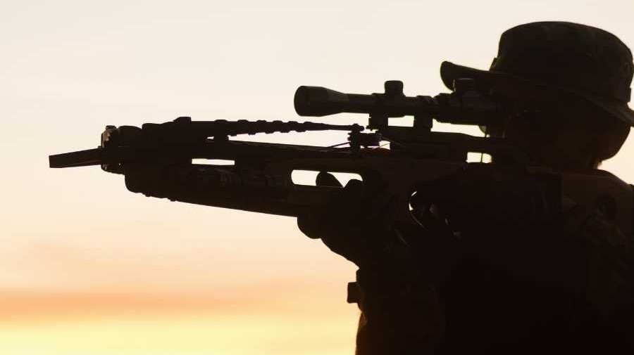 man shoots a crossbow